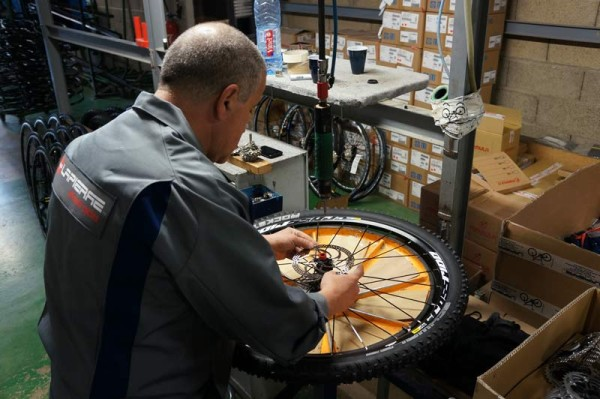 Lapierre Cycles headquarters tour - wheel tire and rotor assembly station