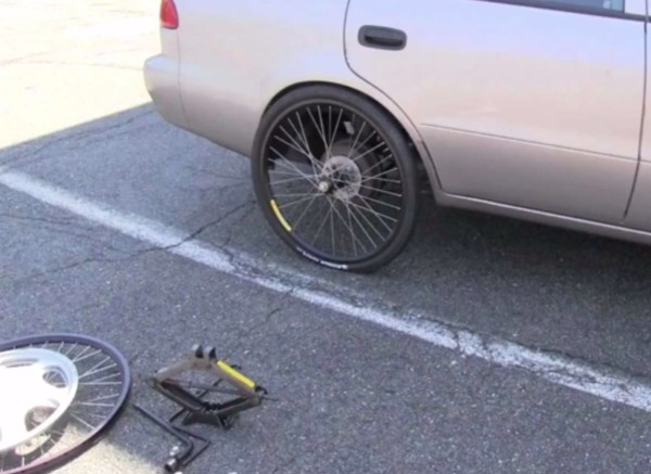 Car on bicycle wheel