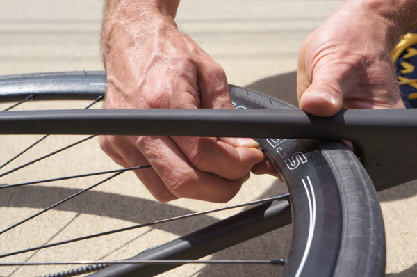 how to true a bicycle wheel on the road or trail without tools so you can keep riding