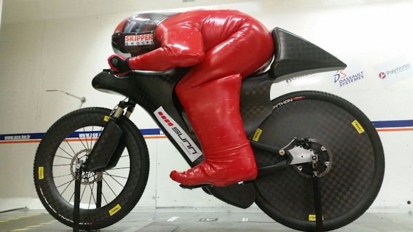 Eric Barone in speed suit on bike