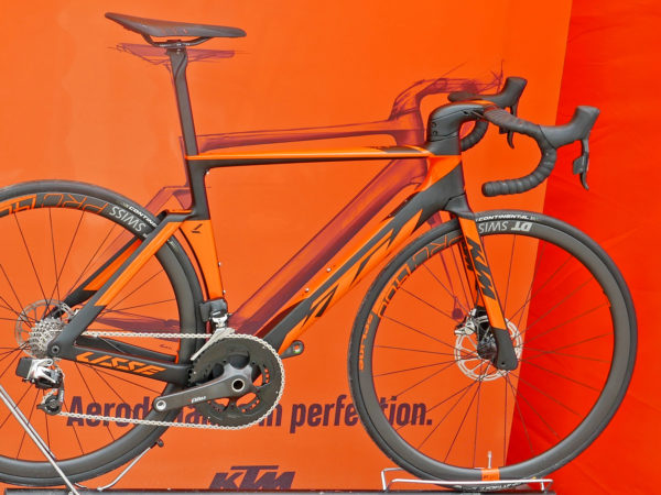 KTM Revelator Lisse fully-integrated cockpit carbon disc-brake aero road bike orange Prestige complete