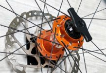 lindarets secure wall mount storage for thru axle bicycle wheels