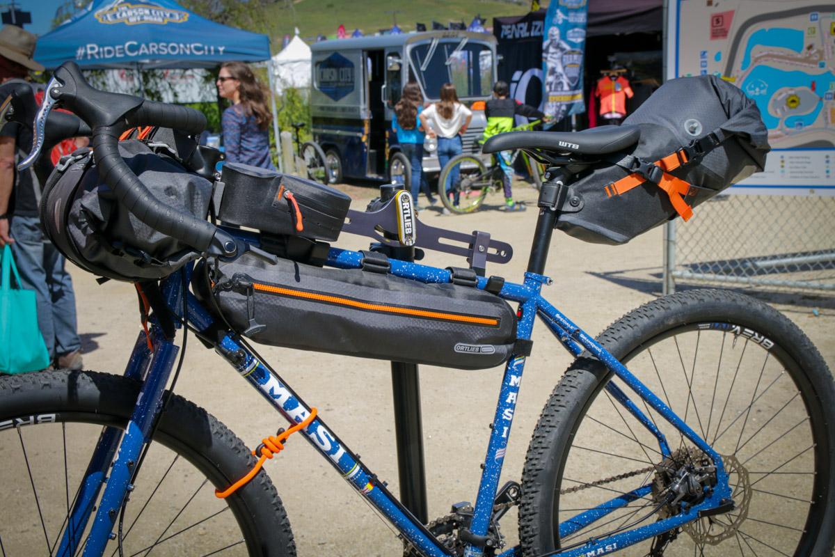 SOC18 Roundup: Packs, bags, and cages from EVOC, Ortleib, Dakine, Topeak, & more