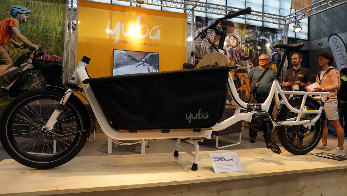 2019 Yuba Electric Supermarche e-cargo bike with up front kids seat and rain cover