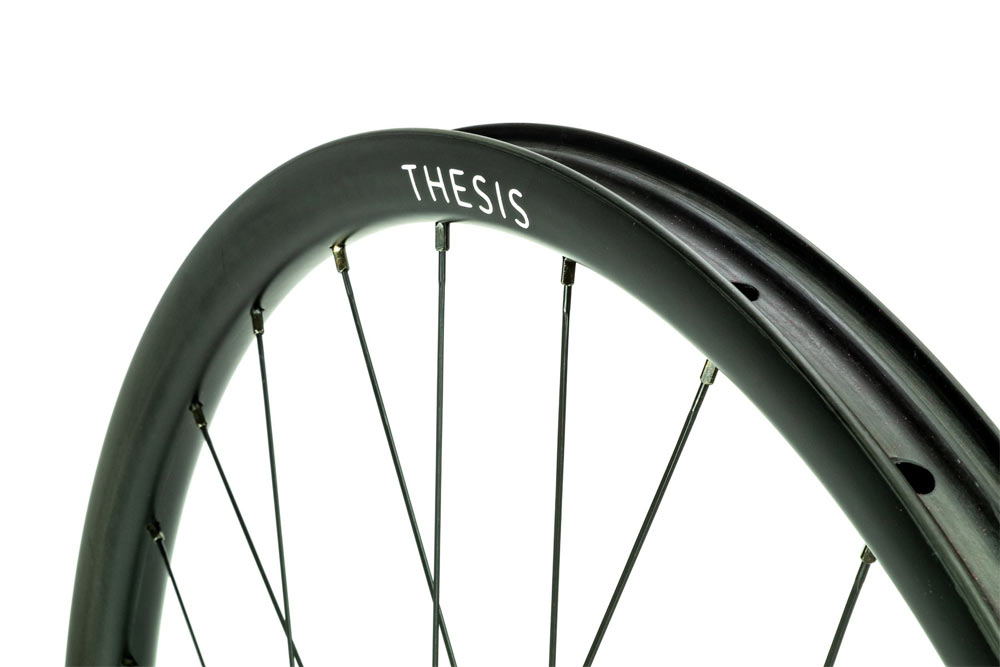 Thesis ultra wide aero carbon fiber road and gravel bike wheels with graphene fibers to improve strength and impact resistance