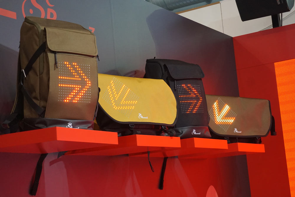 rodewarez backpacks and messenger bags for commuter cyclists with built in turn signals and brake lights