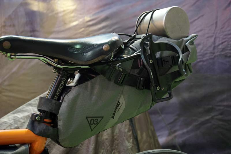 Woho bikepacking saddle roll top bag with stabilizer so it won't sway