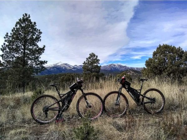 bikerumor pic of the day biking Cedar Creek Trail system in the Lincoln National Forest in Ruidoso, NM. In the background is the Sierra Blanca mountain Peak, which is on the Mescalero Apache Indian Reservation.