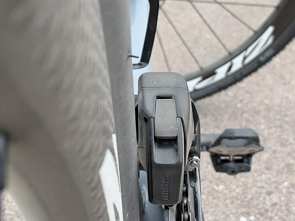 The new sram red etap axs front derailleur battery has more tire clearance