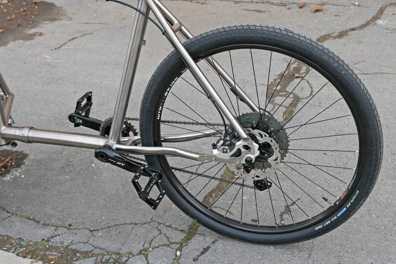 Catan titanium Cargobike lightweight mixed-surface gravel cargo bike, unique linkage arm steering engineered flex