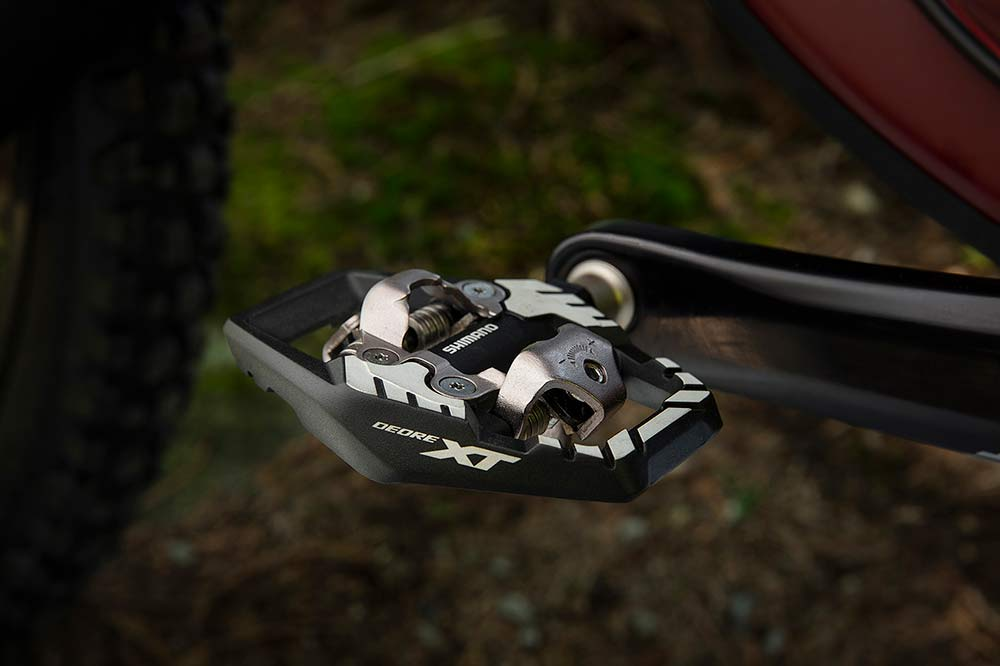 new XT M8100 trail pedals have a larger platform to better support your shoes and feet