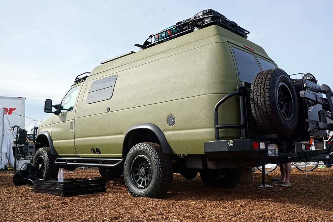 sportsmobile full size van with orange peel paint and lift kit for offroad camping