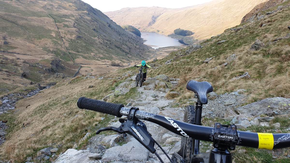 bikerumor pic of the day mountain biking over Nan Bield Pass in the eastern lake district national park in UK