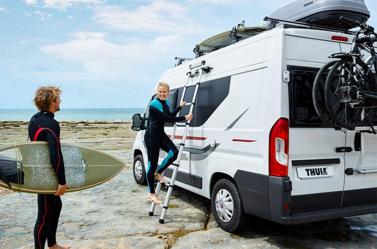 thule collapsible ladder secures to side of vehicle with magnets so it won't slip or wobble