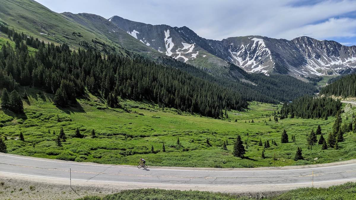bikerumor pic of the day cyclist riding road to loveland pass, colorado.