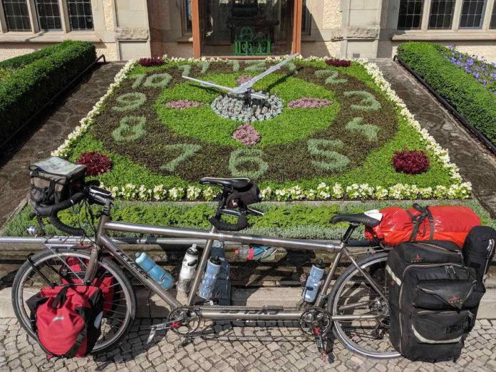 bikerumor pic of the day tandem bicycle in front of a living clock in bernburg germany.