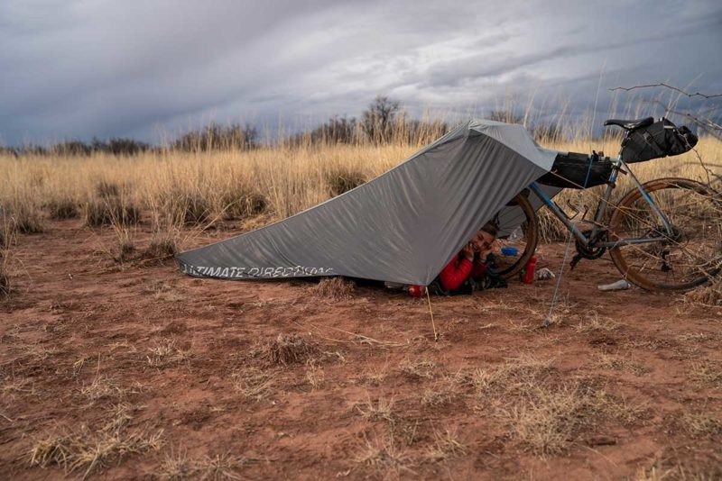 how to use your bike to hold up a tent or tarp and create an emergency shelter