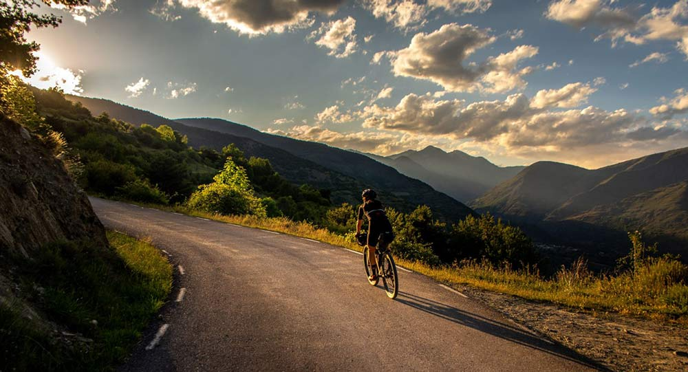 riding gravel bikes through girder forest in the pyrenees in Spain