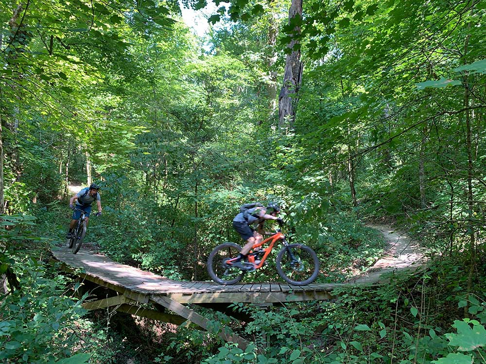 Tyler and Watts riding the Urban Wilderness mountain bike trails in Knoxville