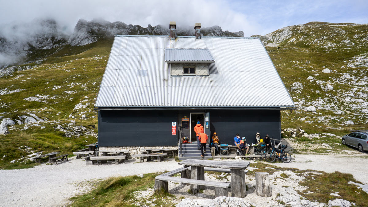 the refuge hut at the top of mangart saddle in slovenia offers beds and food