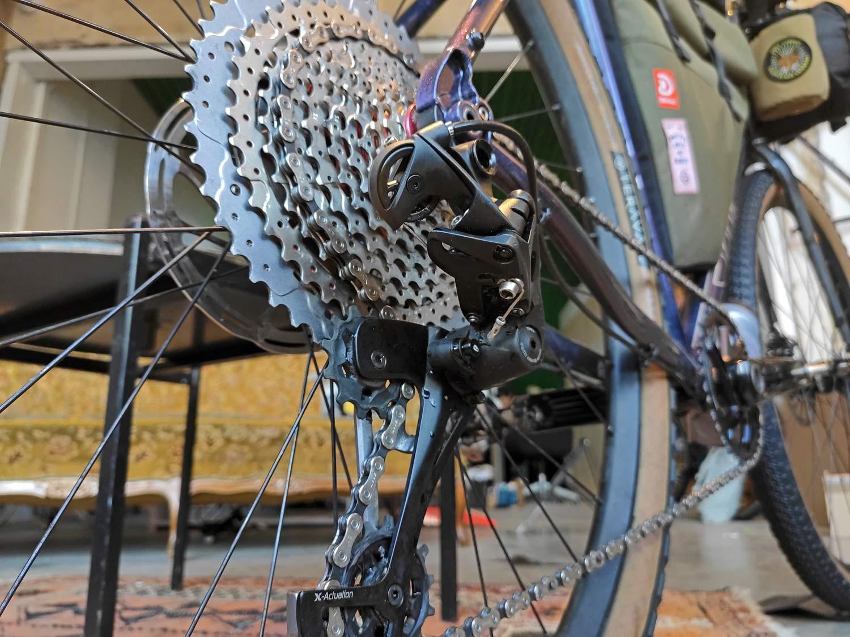 How To SRAM Eagle gravel 1x 11 speed drivetrain hack, Parallel Handbuilt BudgetMullet drop bar wide range adventure bike 1x11 drivetrain conversion