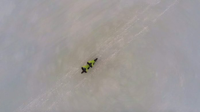 bikerumor pic of the day aerial view of tandem fat bike riders crossing the snowy icy plain in Gello, Norway.