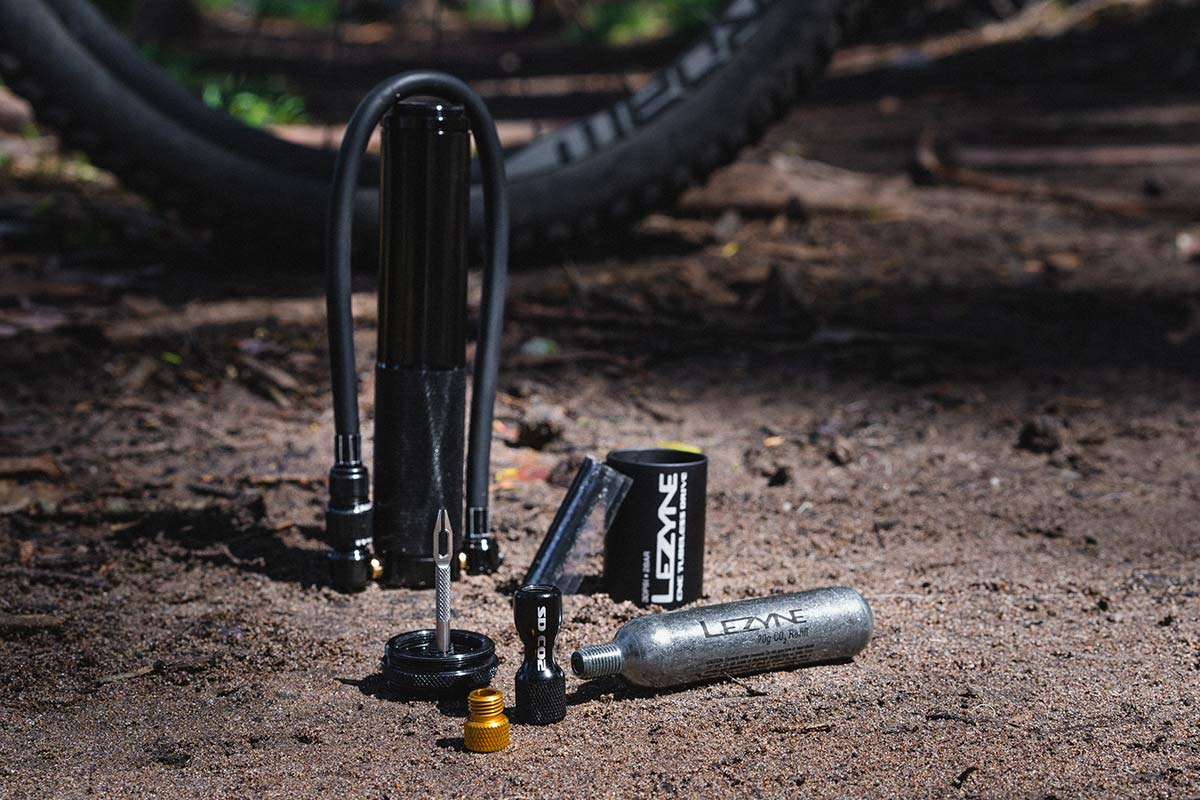 lezyne mini pump with tire puncture repair kit inside the handle and integrated co2 cartridge