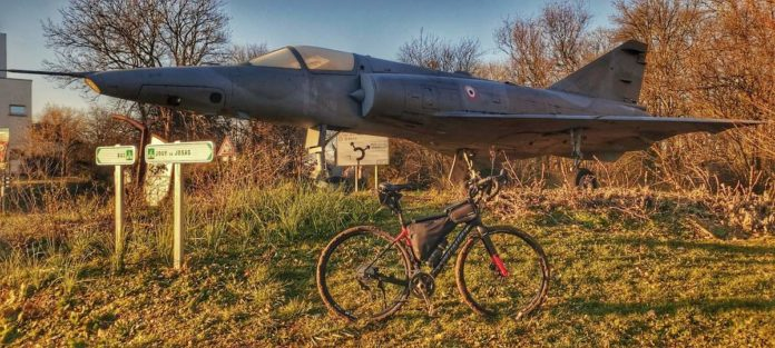 bikerumor pic of the day specialized diverge sitting in front of a mirage 3-r outside of buc france.