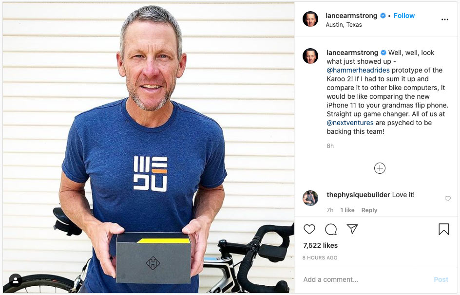 lance armstrong shows off box for the new hammerhead karoo 2 gps cycling computer