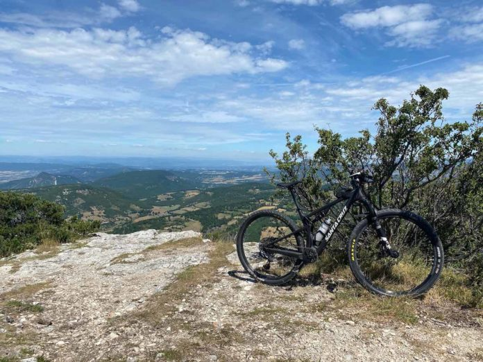 bikerumor pic of the day Dieulefit, Southern France. santa cruz on top of a rocky hill overlooking green valley.