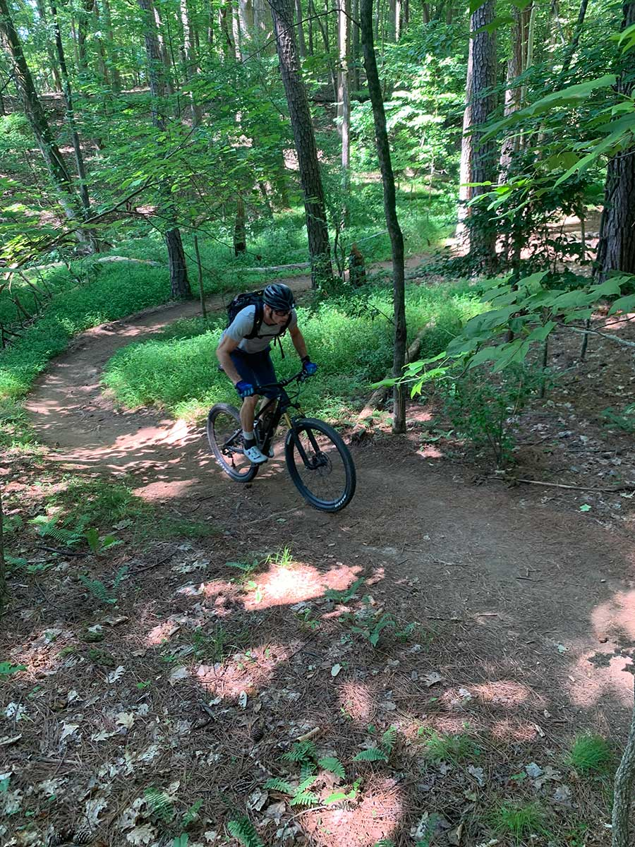 the YT Izzo is a mid travel mountain bike that can climb well without a lockout