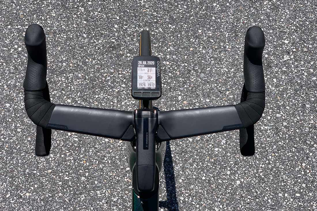 specialized tarmac sl7 aero road bike review with closeup detail of the aerodynamic one piece handlebar and stem with hidden cable routing