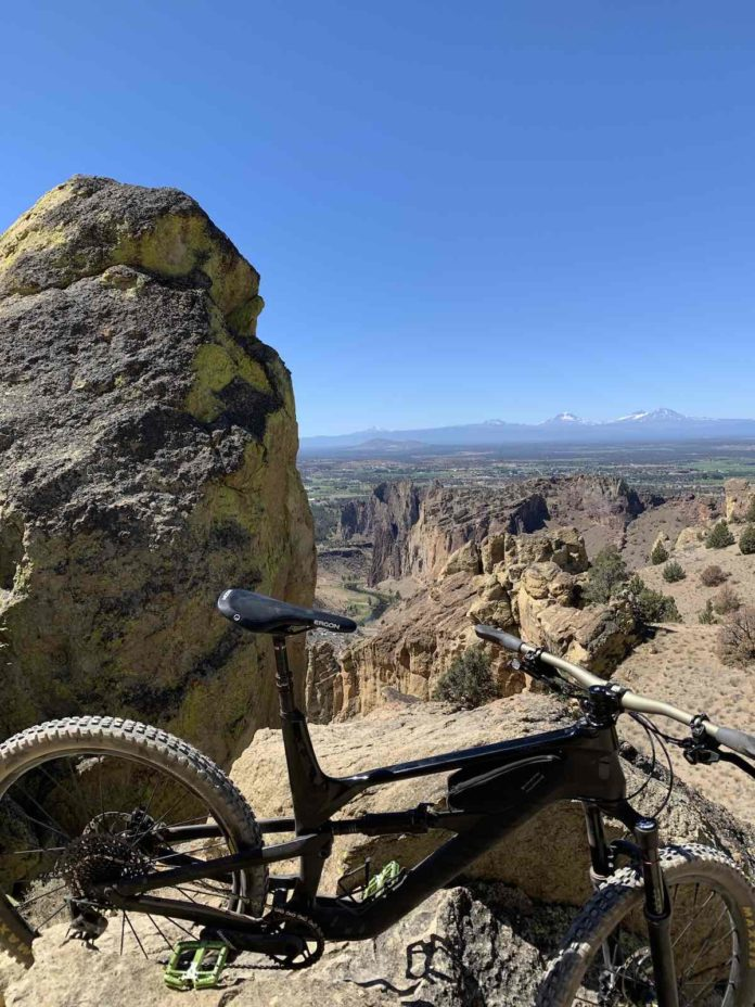 bikerumor pic of the day smith rock state park oregon rocky mountain overlooking snow capped mountains in the distance