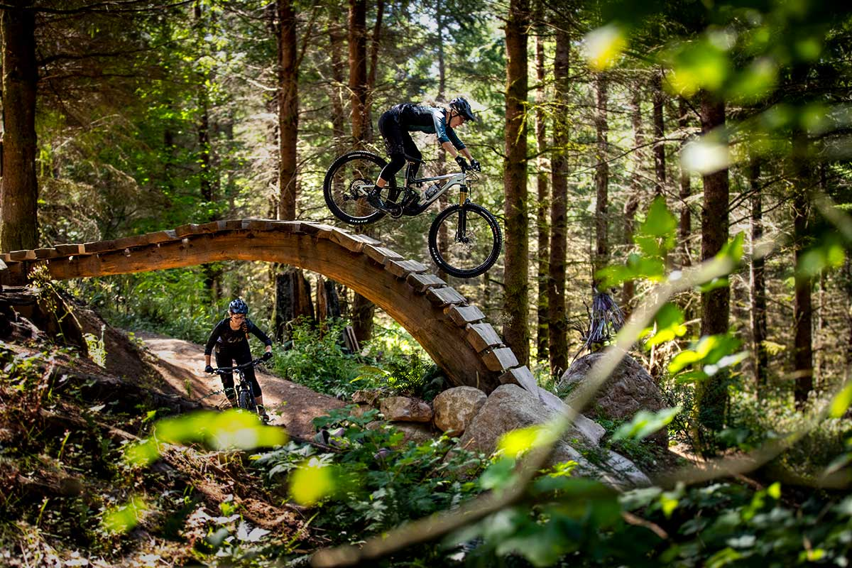 liv intrigue advanced pro29 low geometry setting optimized for descending female mountain biker sends gnarly north shore feature