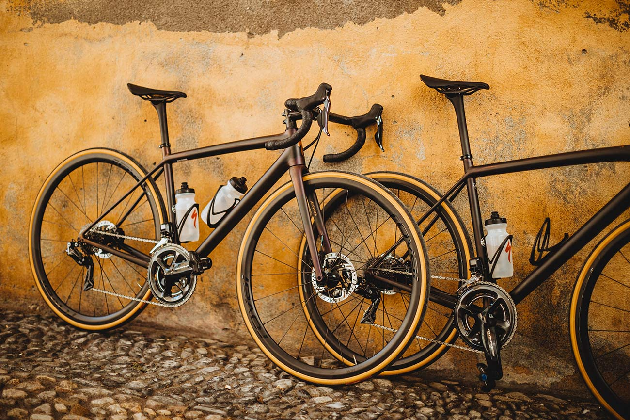 specialized aethos s works road bikes leaning against a wall
