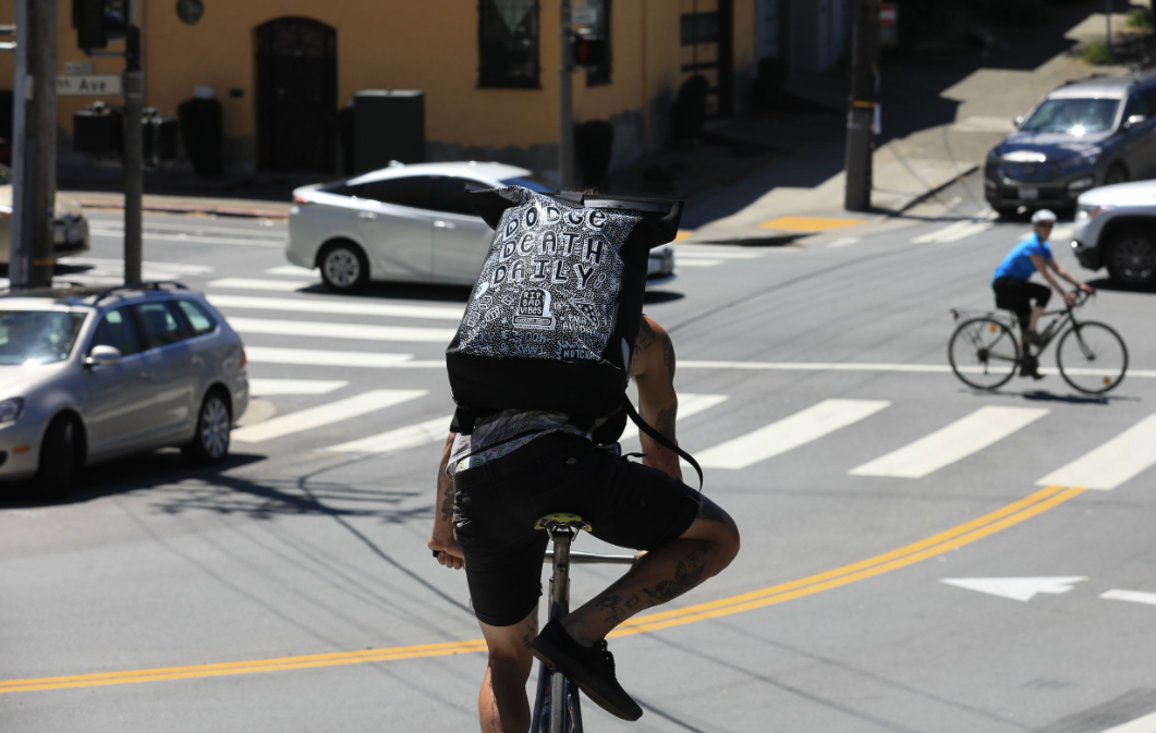 Ortlieb custom bags benefit Cycles of Change rolling in the street