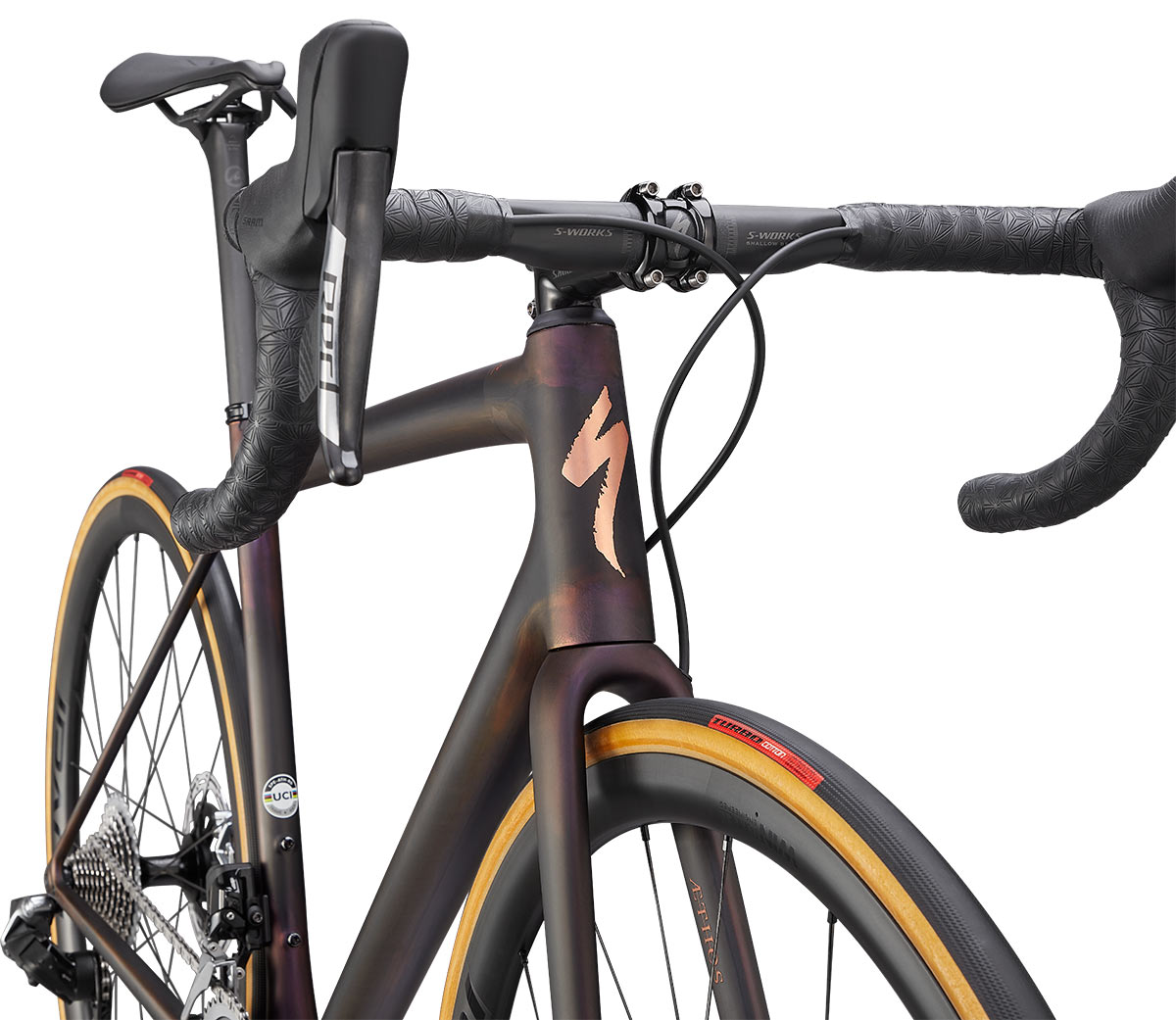 specialized aethos s-works road bike closeup on paint scheme at head tub e