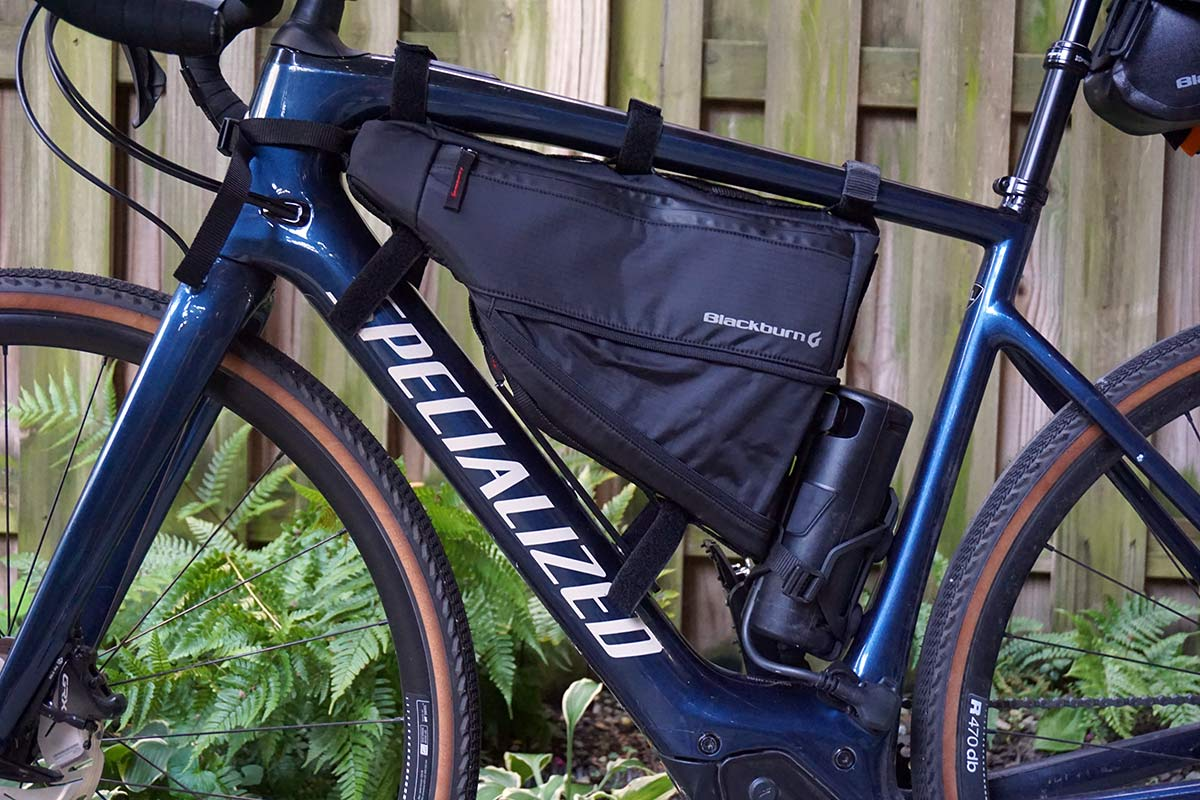blackburn outpost frame bag shown in open expanded position to hold more bikepacking gear