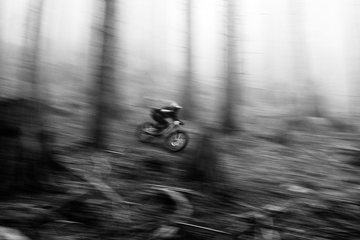 norco shore pan shot fast riding black and white blur forest