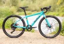salsa journeyman 24 inch wheel size gravel bike for youth shown in teal blue color