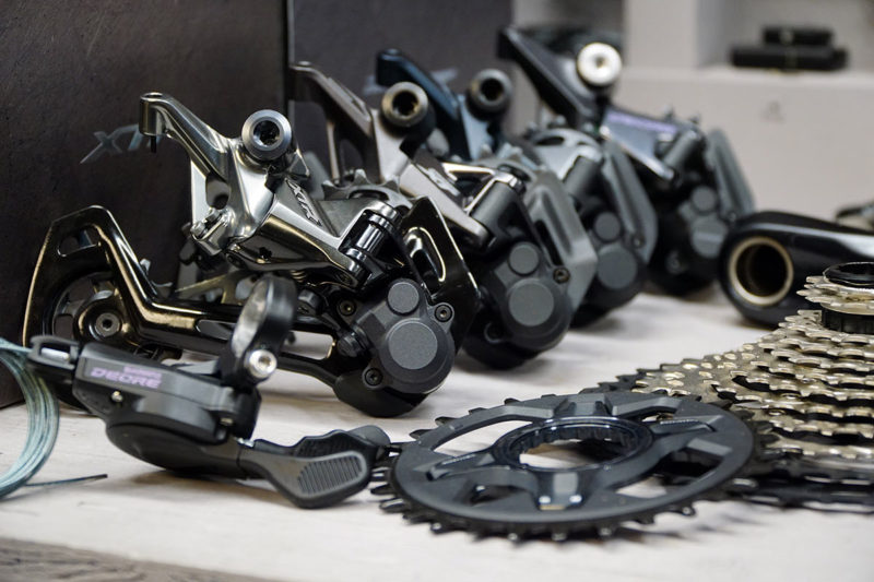 Shimano 12 speed mountain bike group component comparison with all four derailleurs lined up
