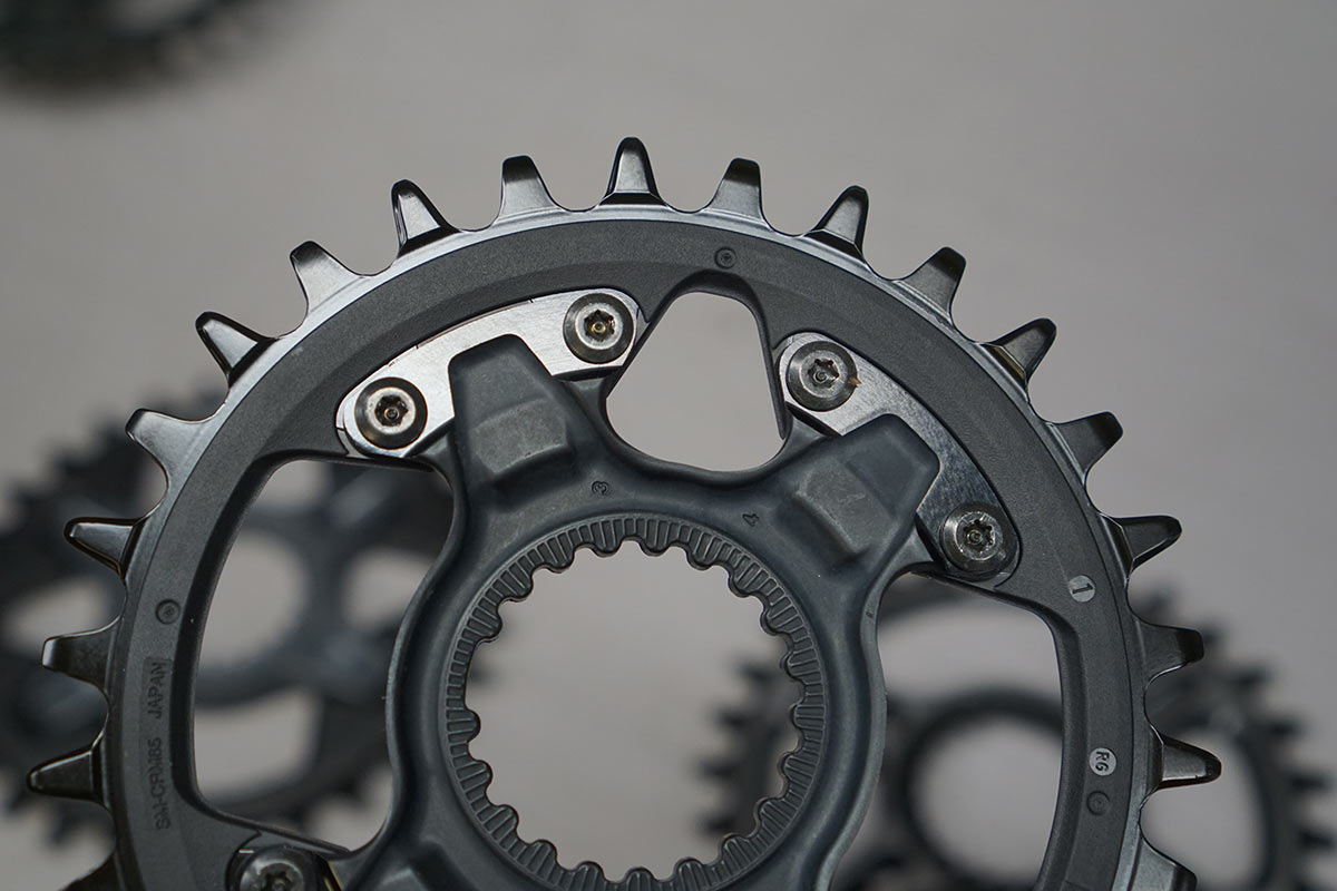 backside of shimano 12 speed chainrings with dynamic chain engagement plus details