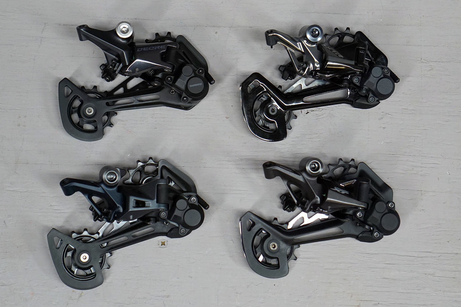 all four shimano 12 speed MTB rear derailleurs compared side by side