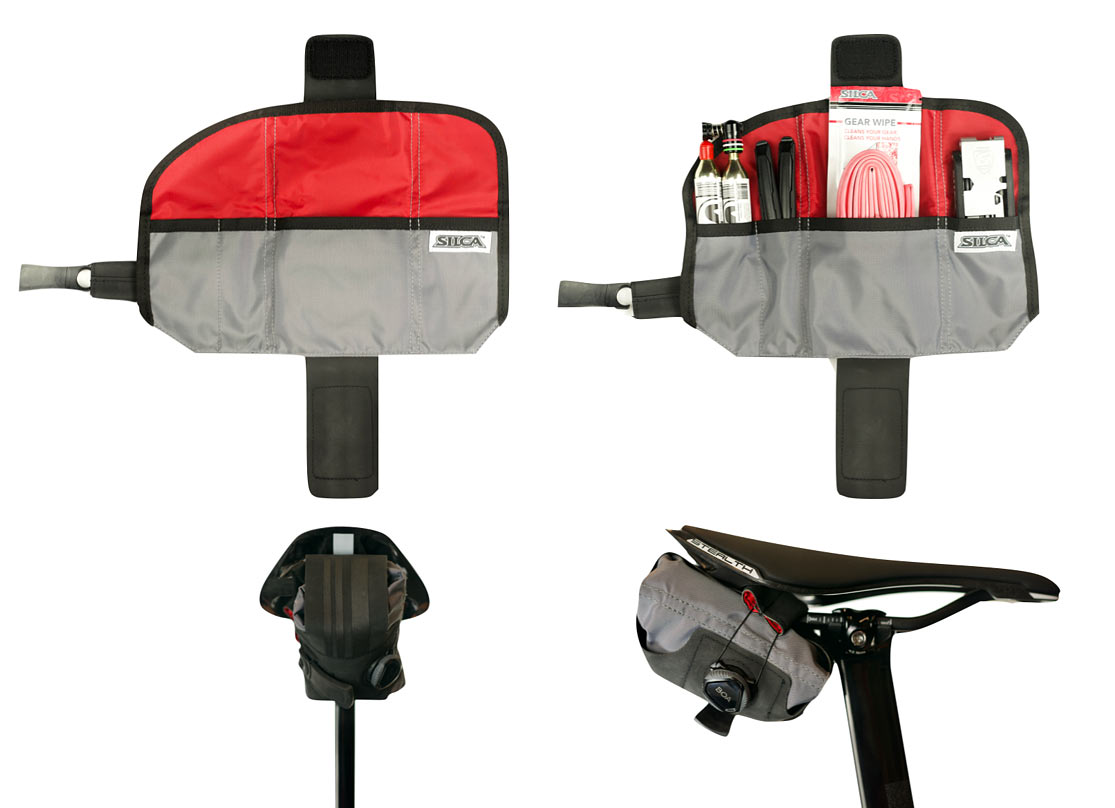 new silca seat roll asymmetrico saddle bag with boa closure shown laid open and packed with tools