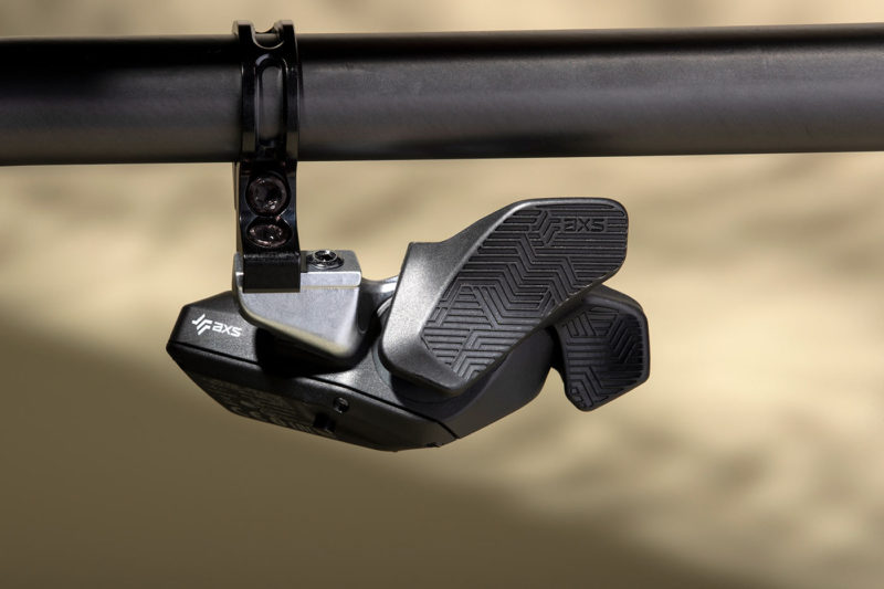 sram eagle axs wireless shifter with trigger style button feels more like traditional mechanical shifters