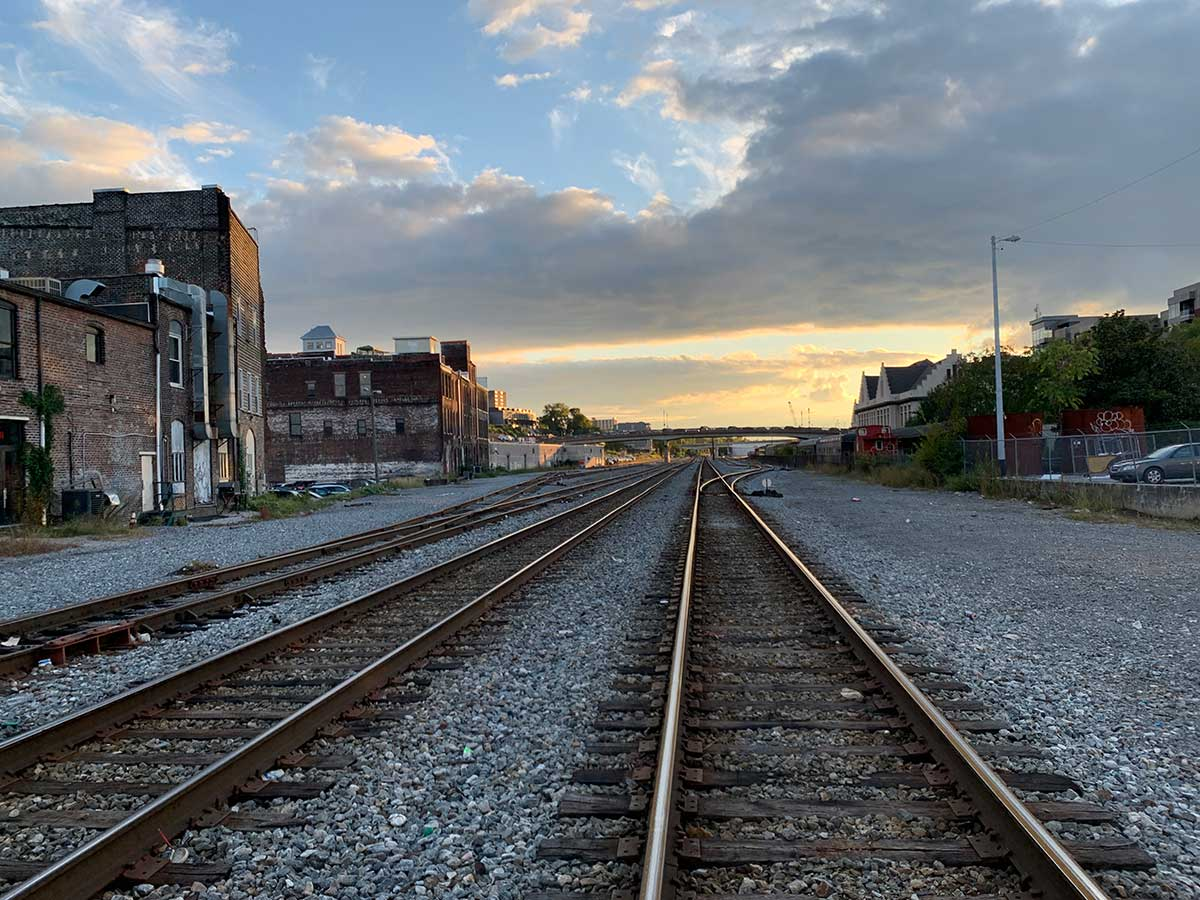 sunset over railroad tracks in downtown knoxville tennessee