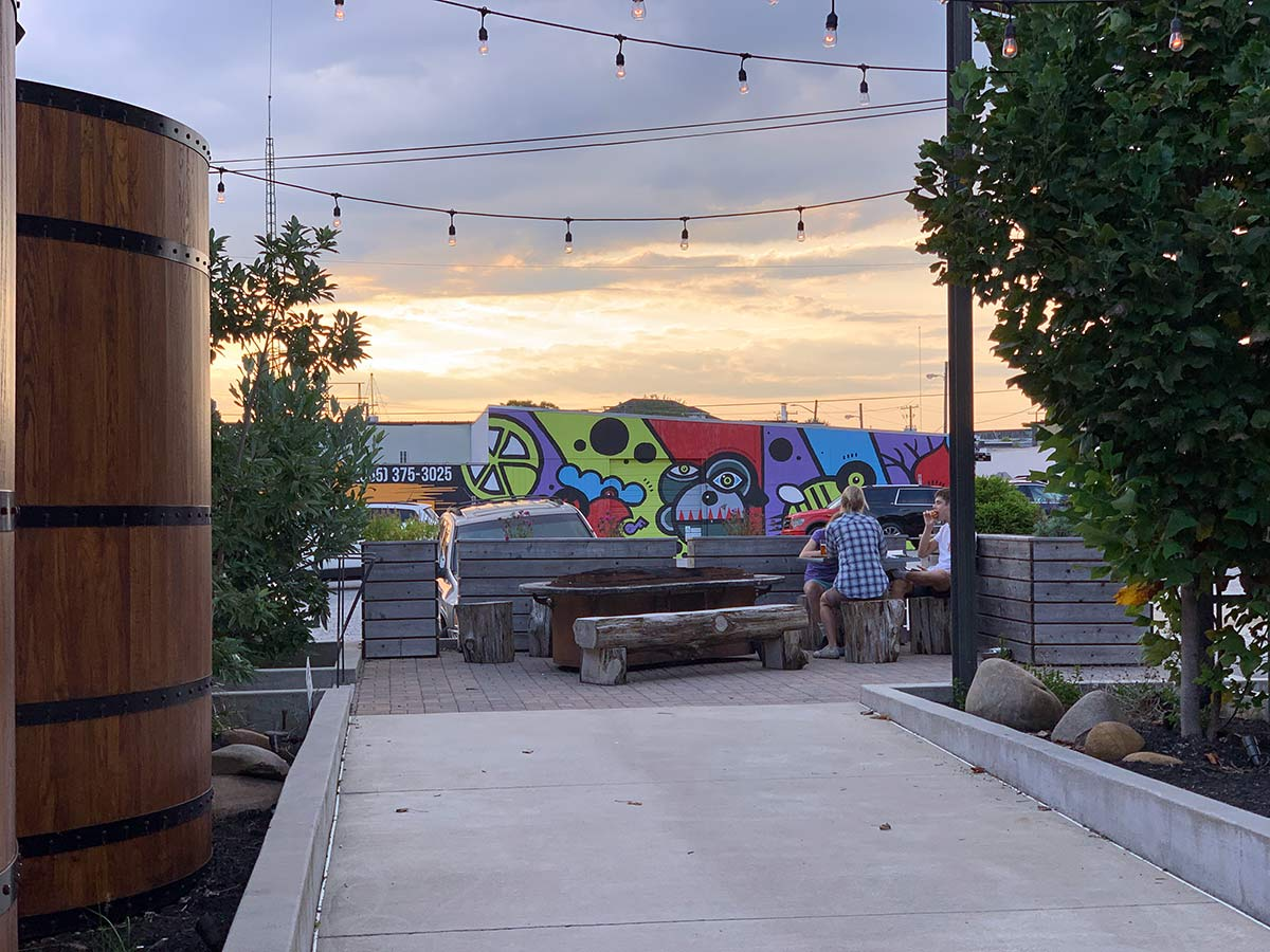 outdoor patio and art as seen from elkmont exchange food and brewery in knoxville