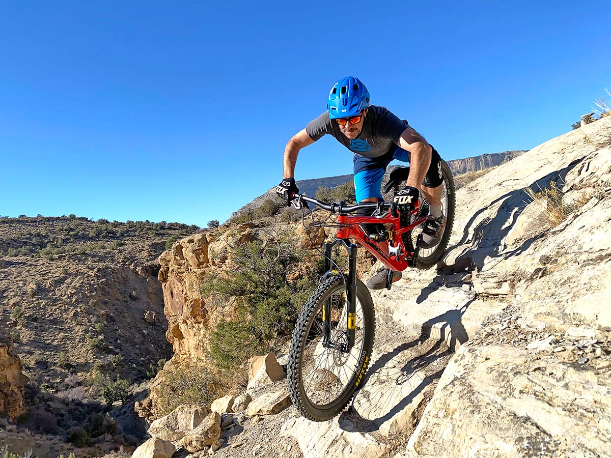 2021 canfield lithium full suspension mountain bike riding on rock drop off