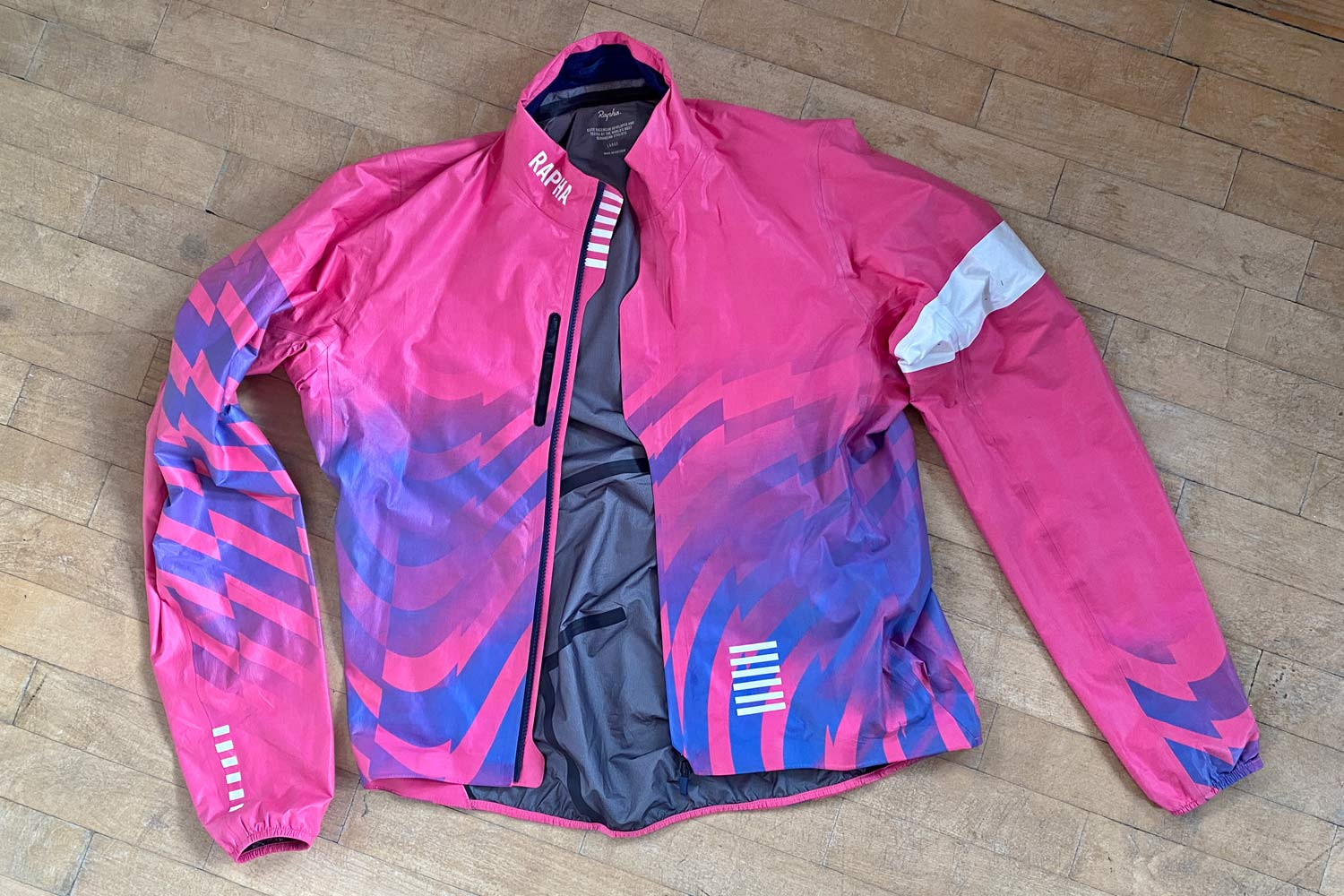 Exclusive Review: Rapha Pro Team Lightweight Gore-Tex Jacket printed in pink Technicolor, extra full color Shakedry visibility