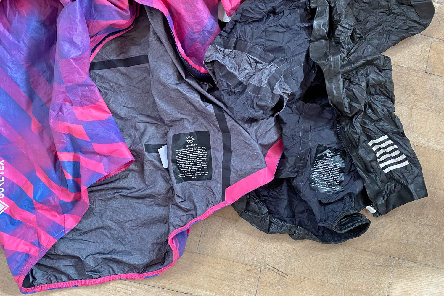 Exclusive Review: Rapha Pro Team Lightweight Gore-Tex Jacket printed in pink Technicolor, extra full color Shakedry visibility,pink vs. black